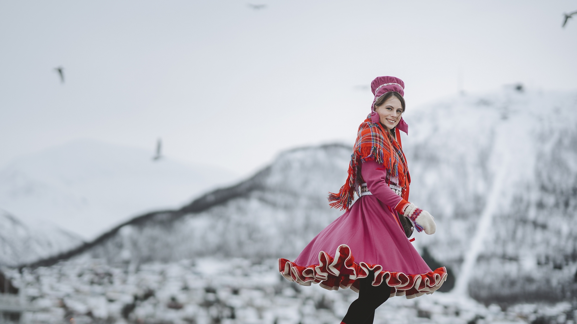 Mariann Josefsen in Sami dress with mountains in the background