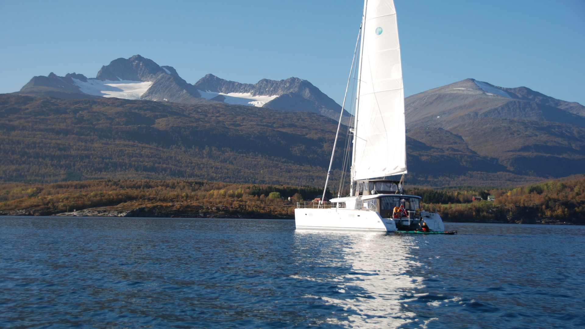The catamaran Arctic Princess sailing in a fjord