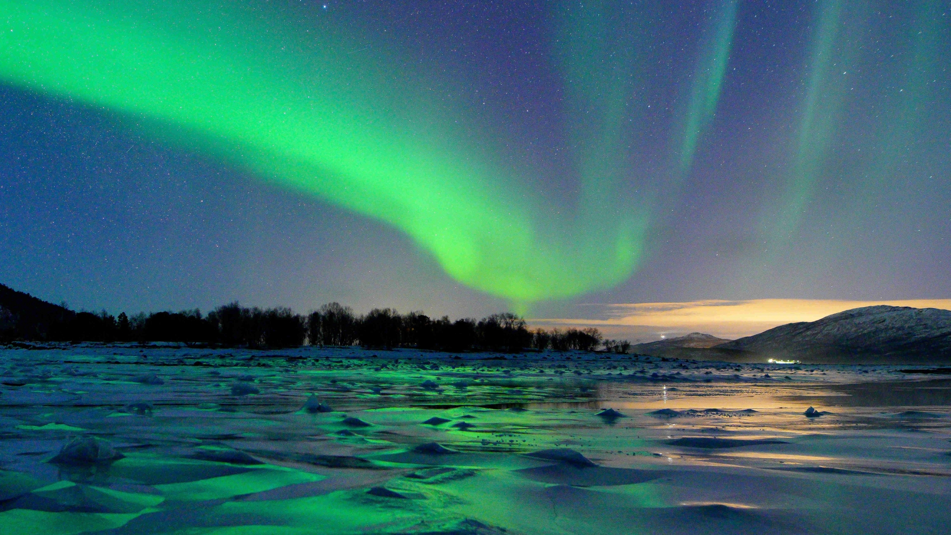 Northern Lights over icy water