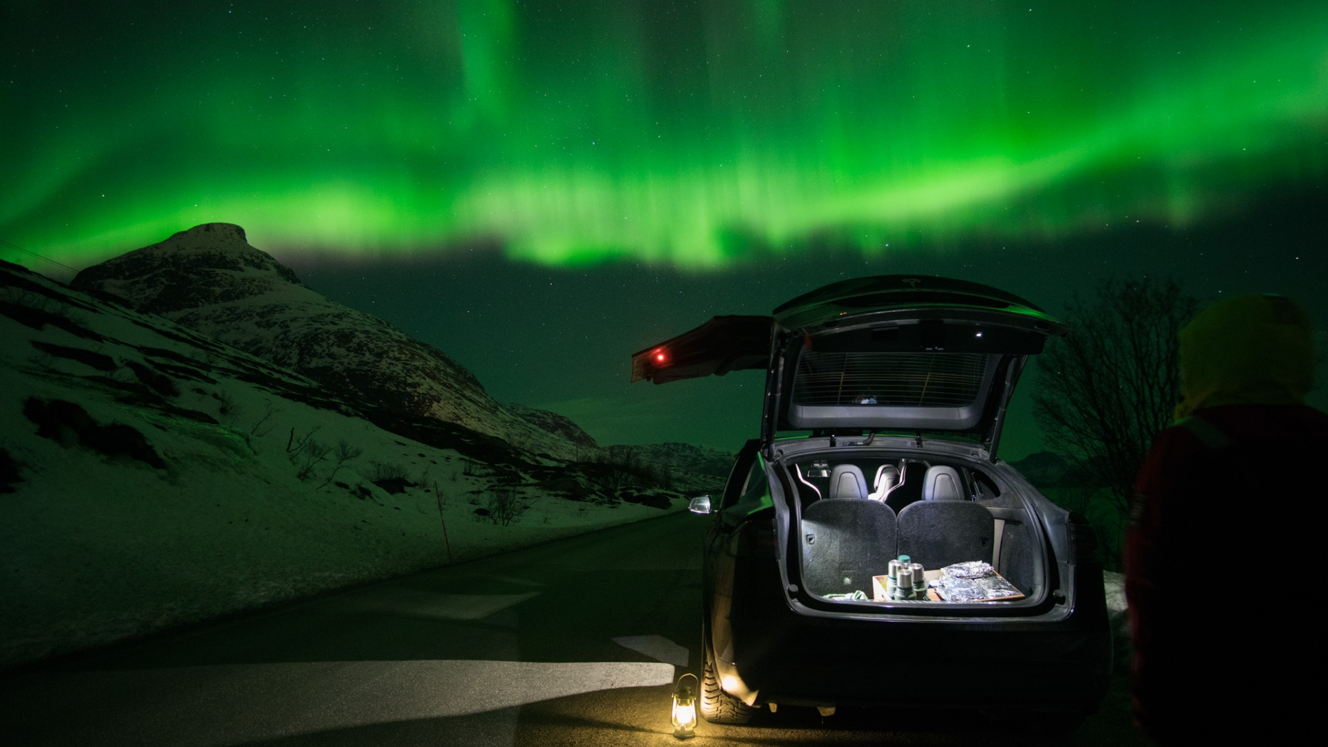 northern lights and a car