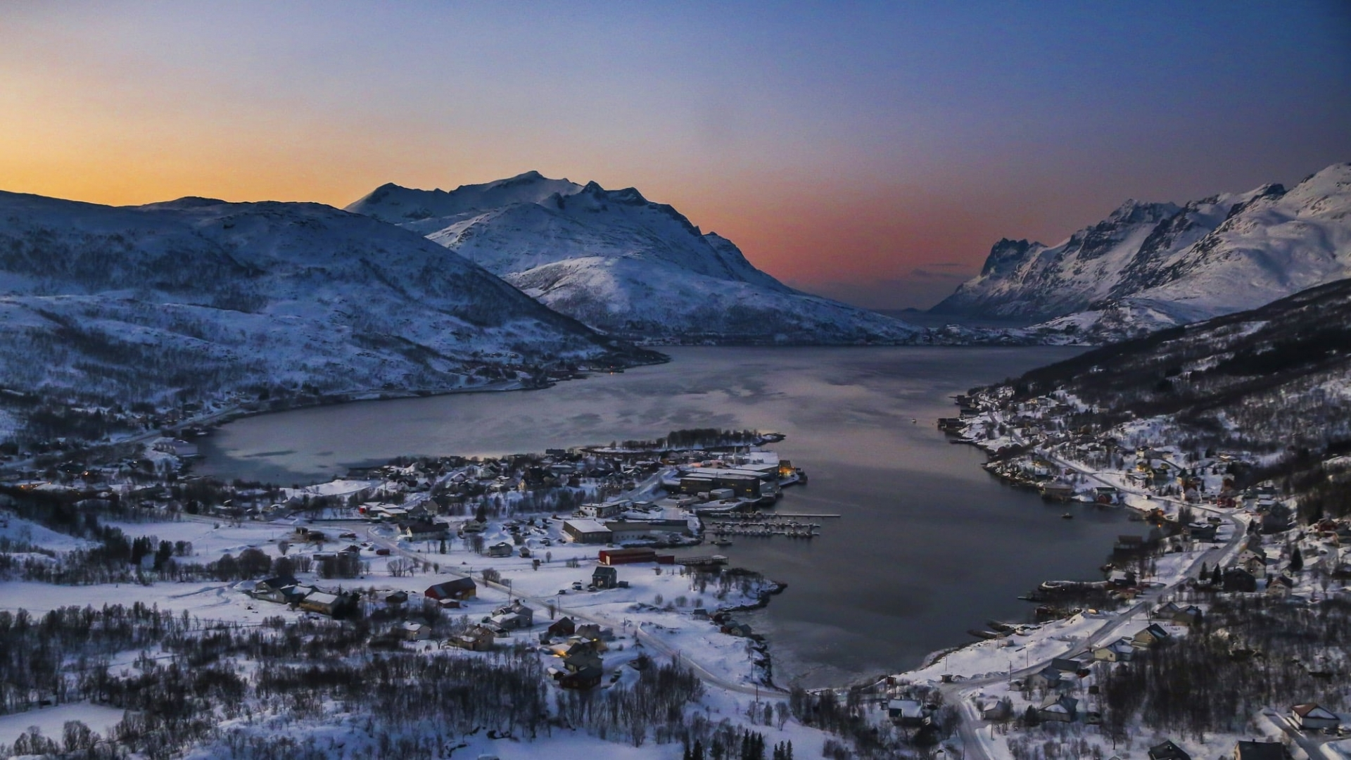 a snow covered fjord