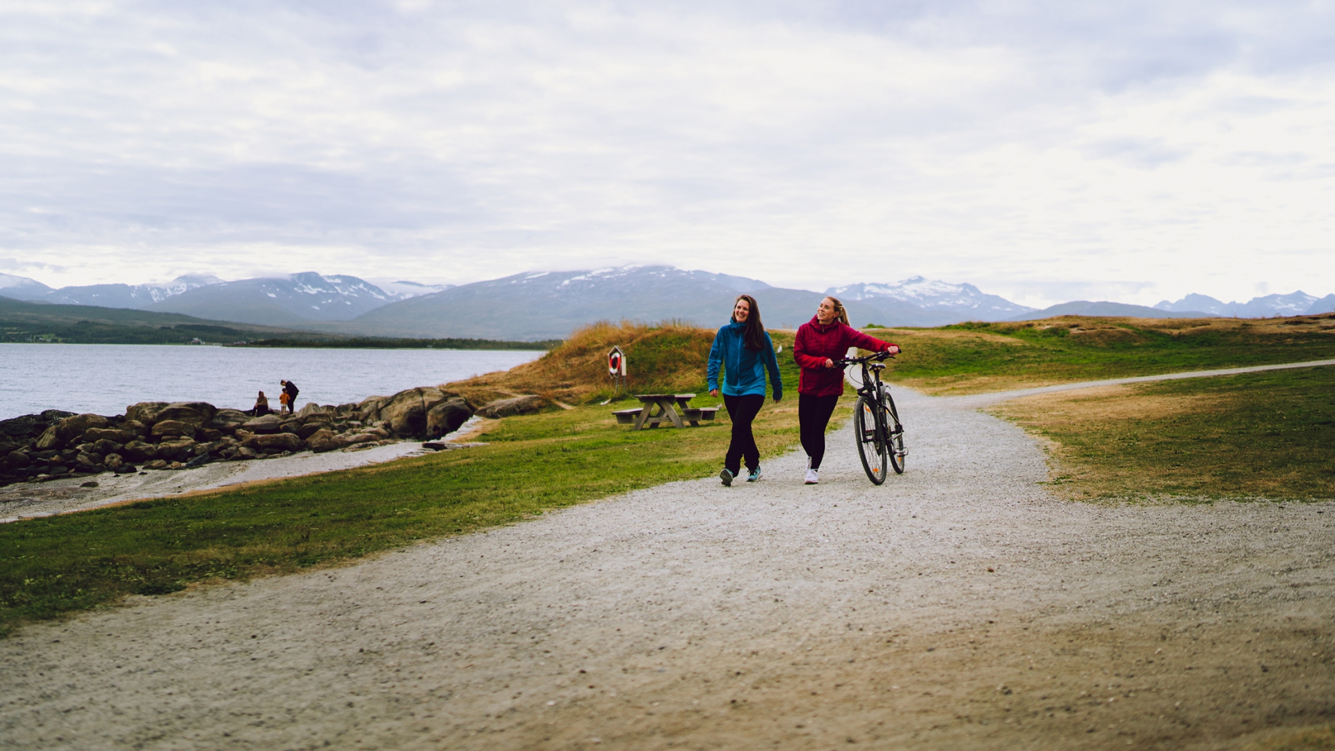 Girls walking with bicycles in Telegrafbukta