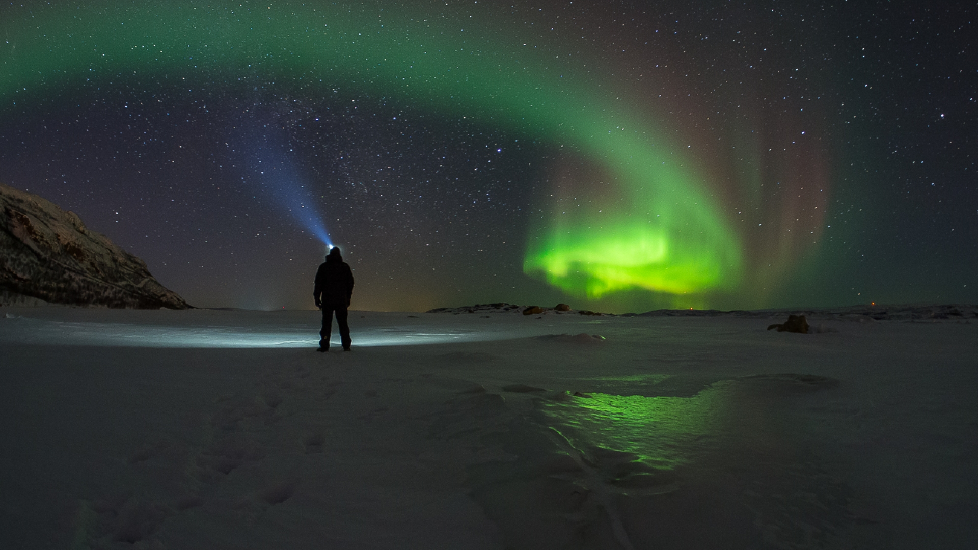 someone looking at the northern lights