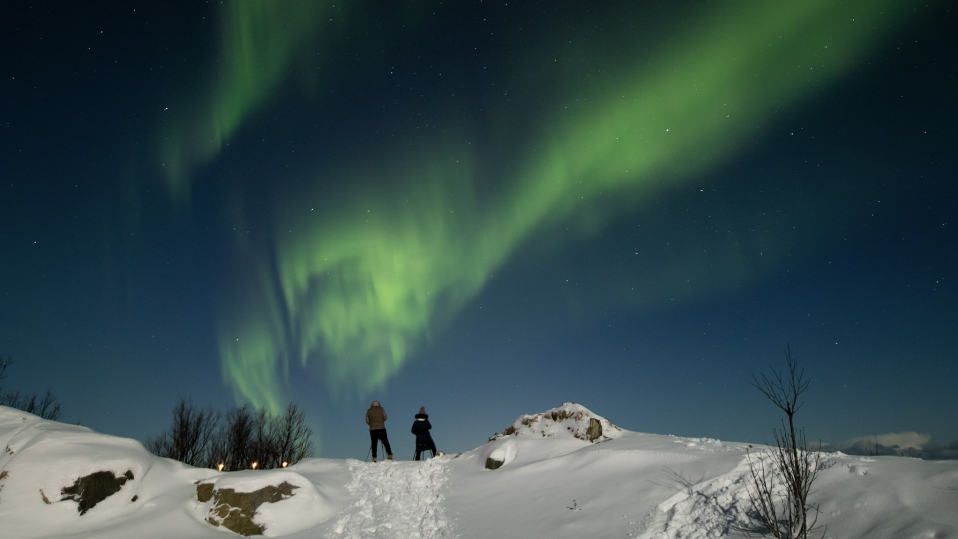 Man and woman watching the Northern Lights