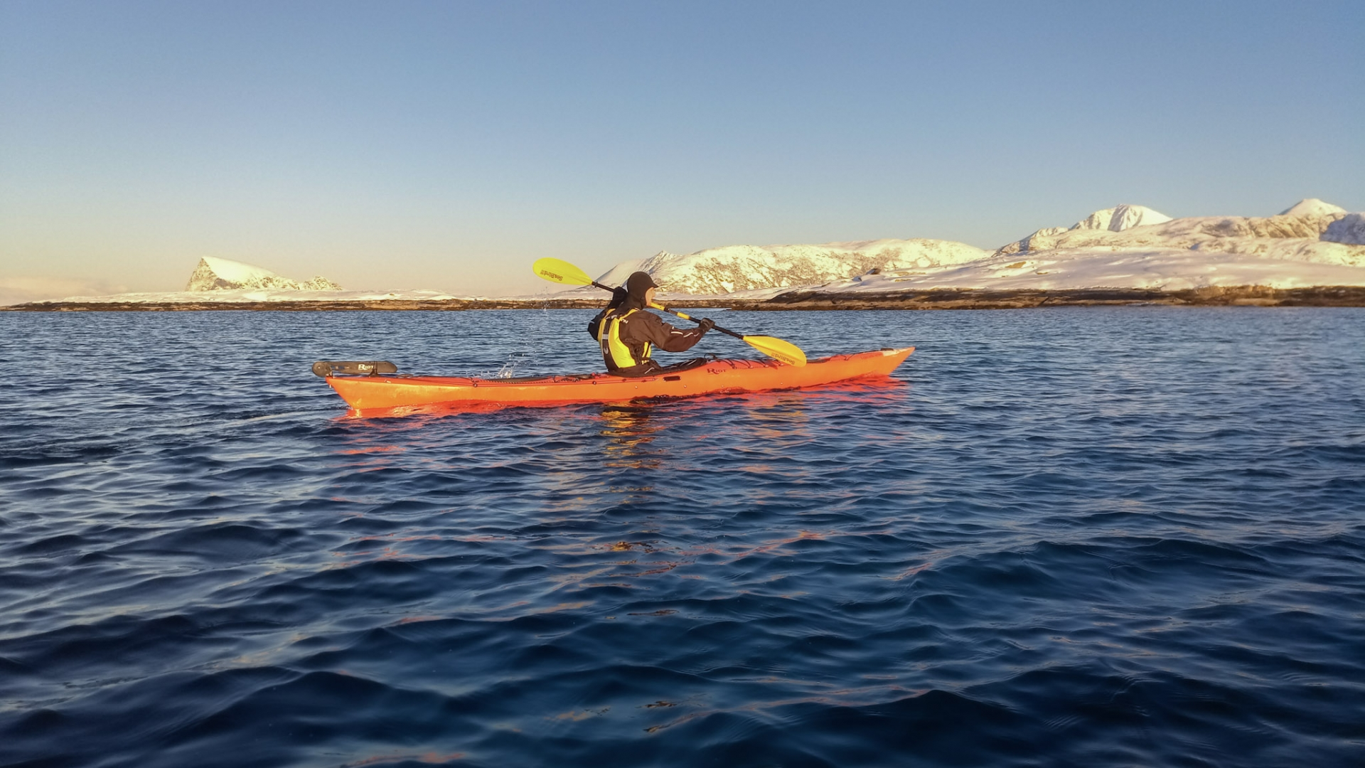 Person kayaking in winter