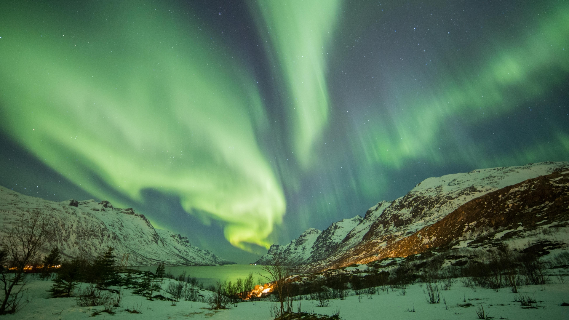 Snowy mountains and Northern Lights