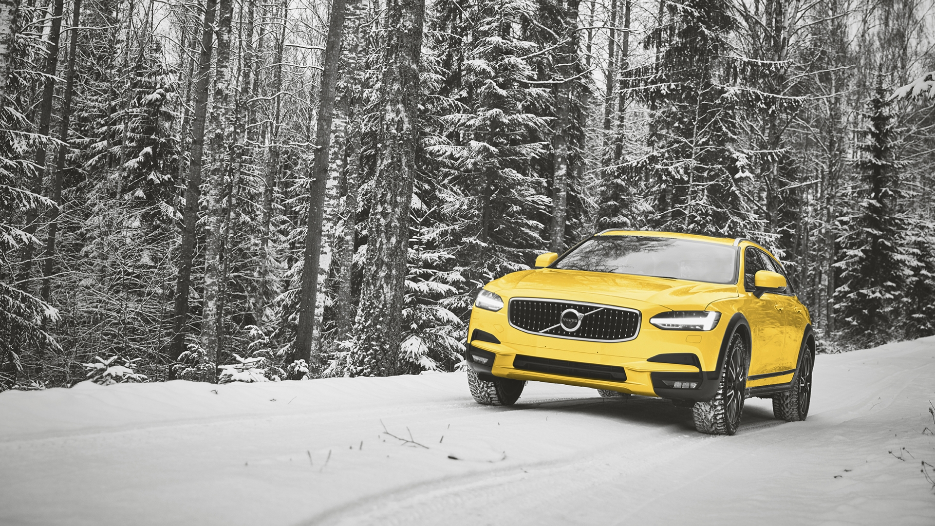Yellow car on snowy winter roads