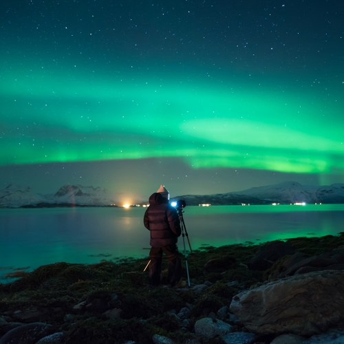 Person photographing the northern lights