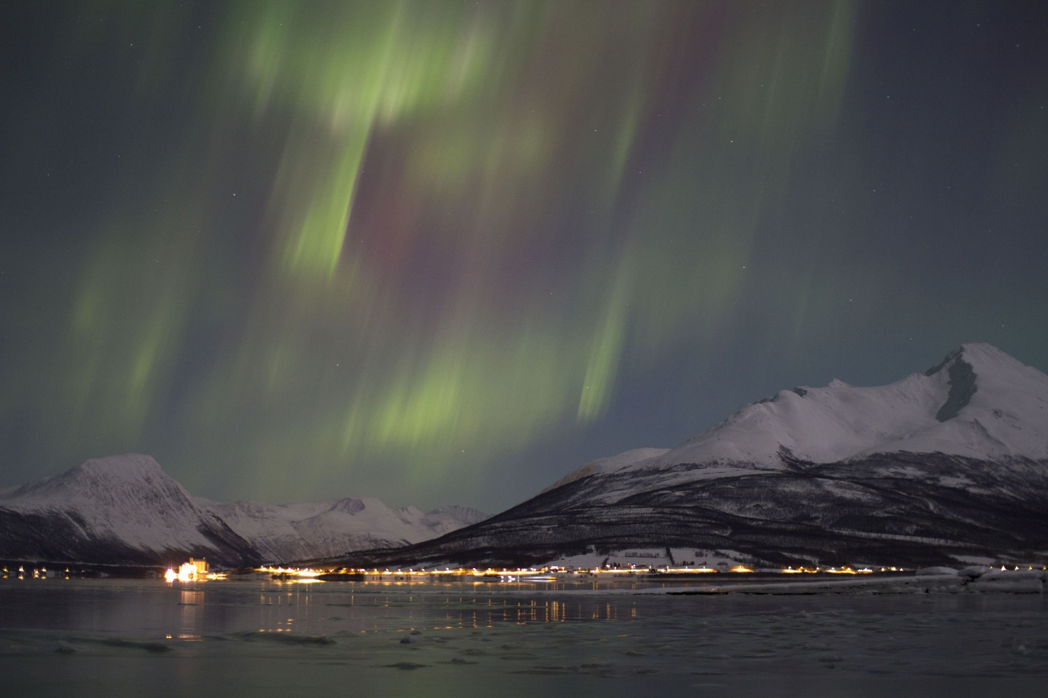 Northern Lights above sea and mountain