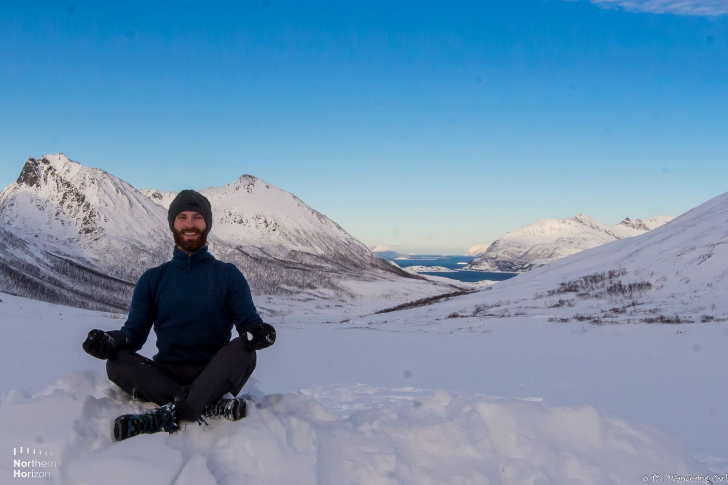 Man doing yoga pose in the snow