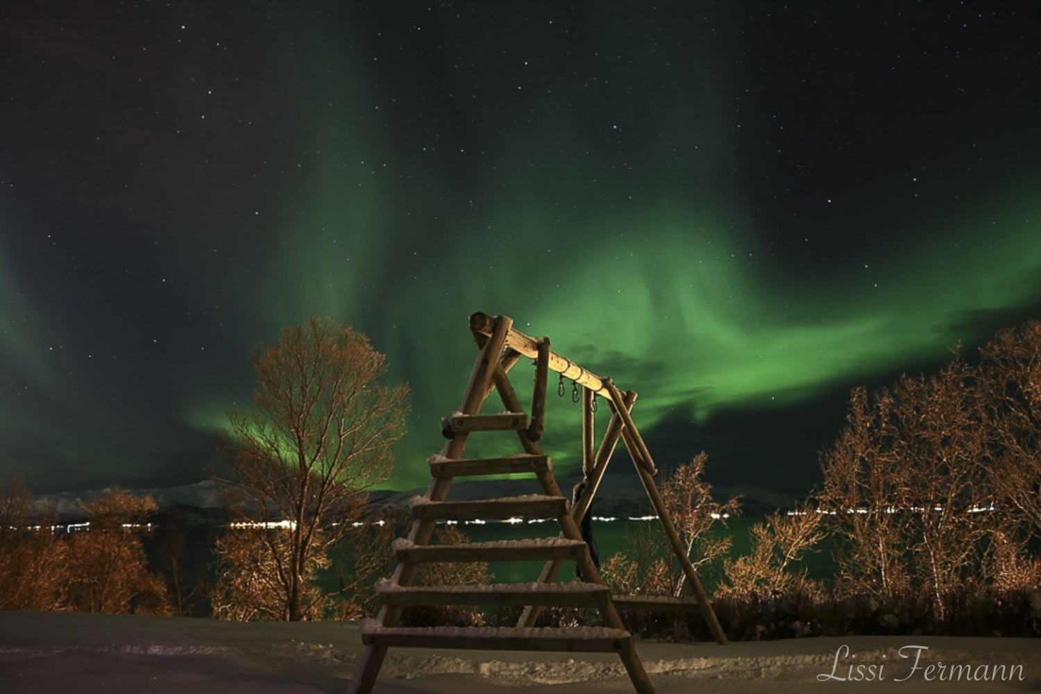 Northern lights above a playground