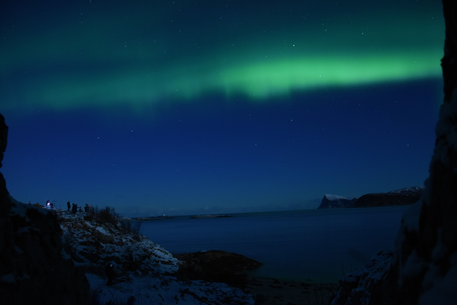 Northern lights above sea and fjord