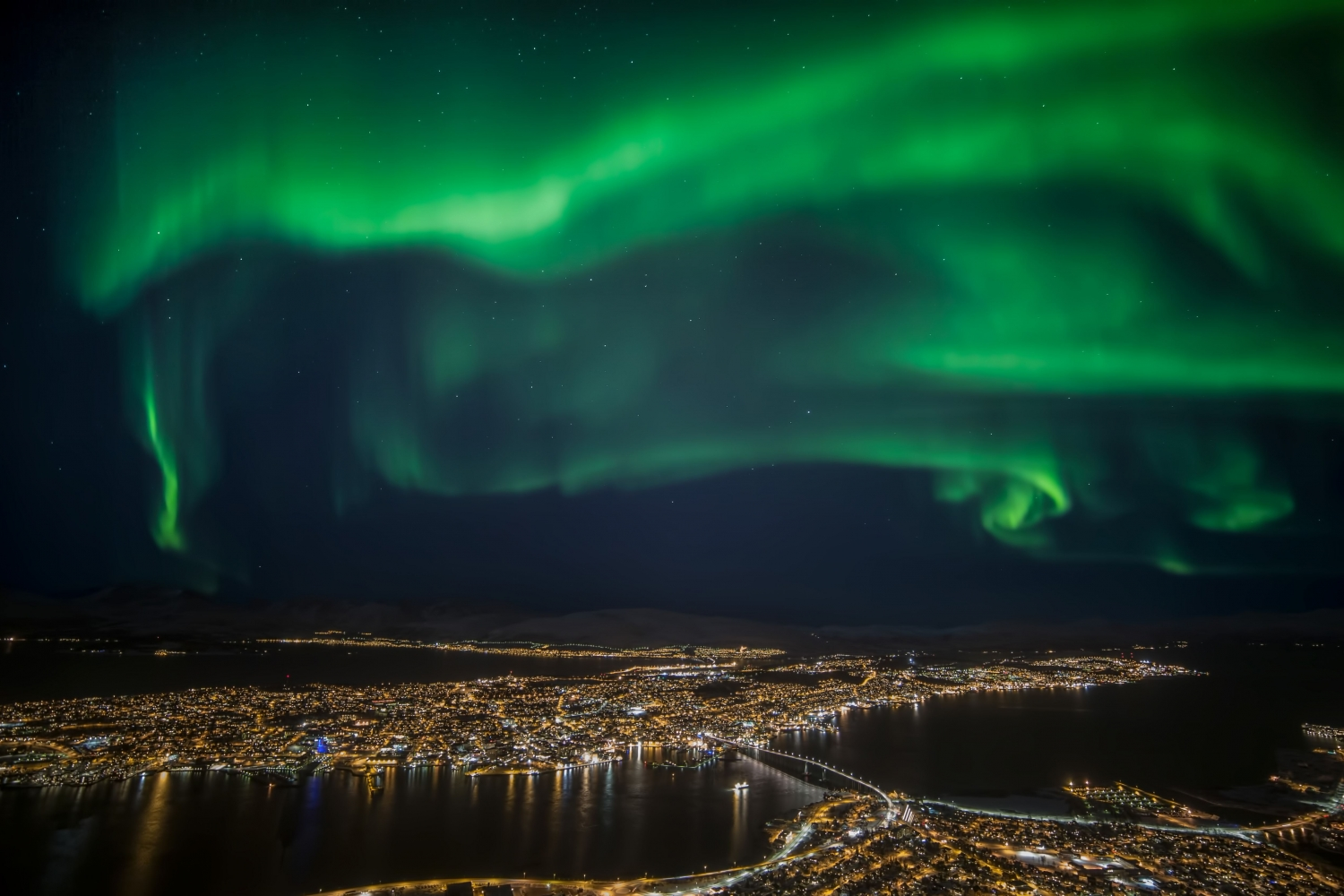 View from the top of the mountain, with Northern Lights above the city