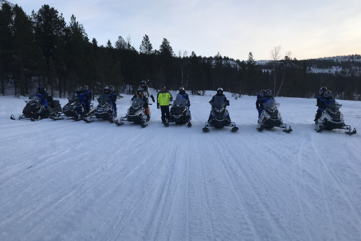 snowmobiles standing in a line
