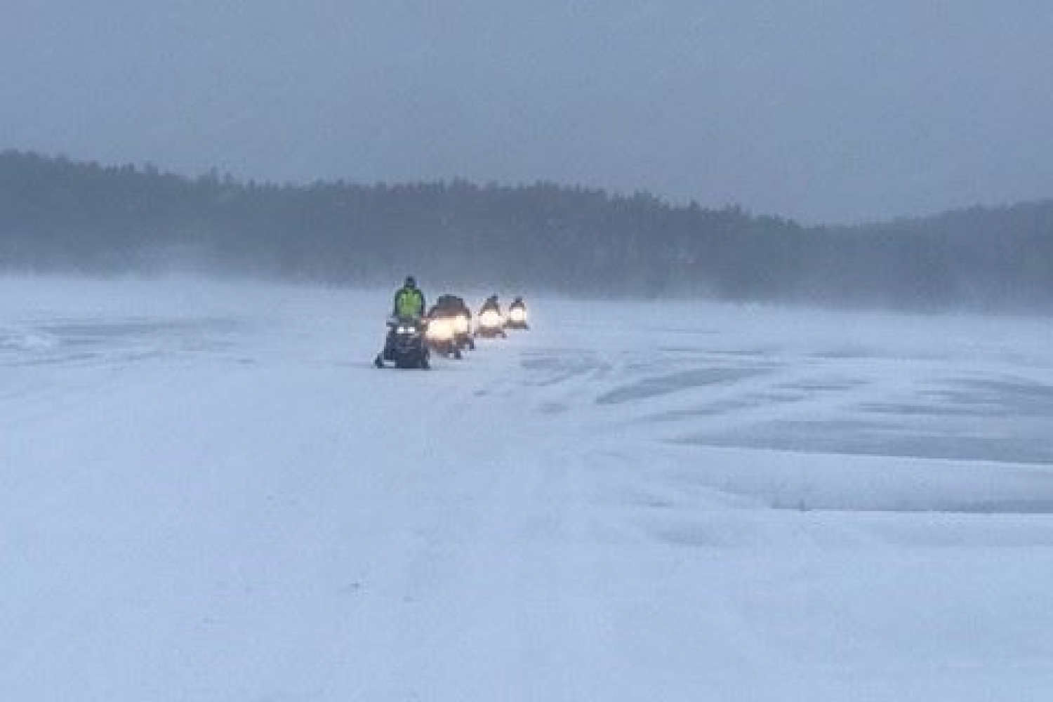 snowmobiles driving in the track