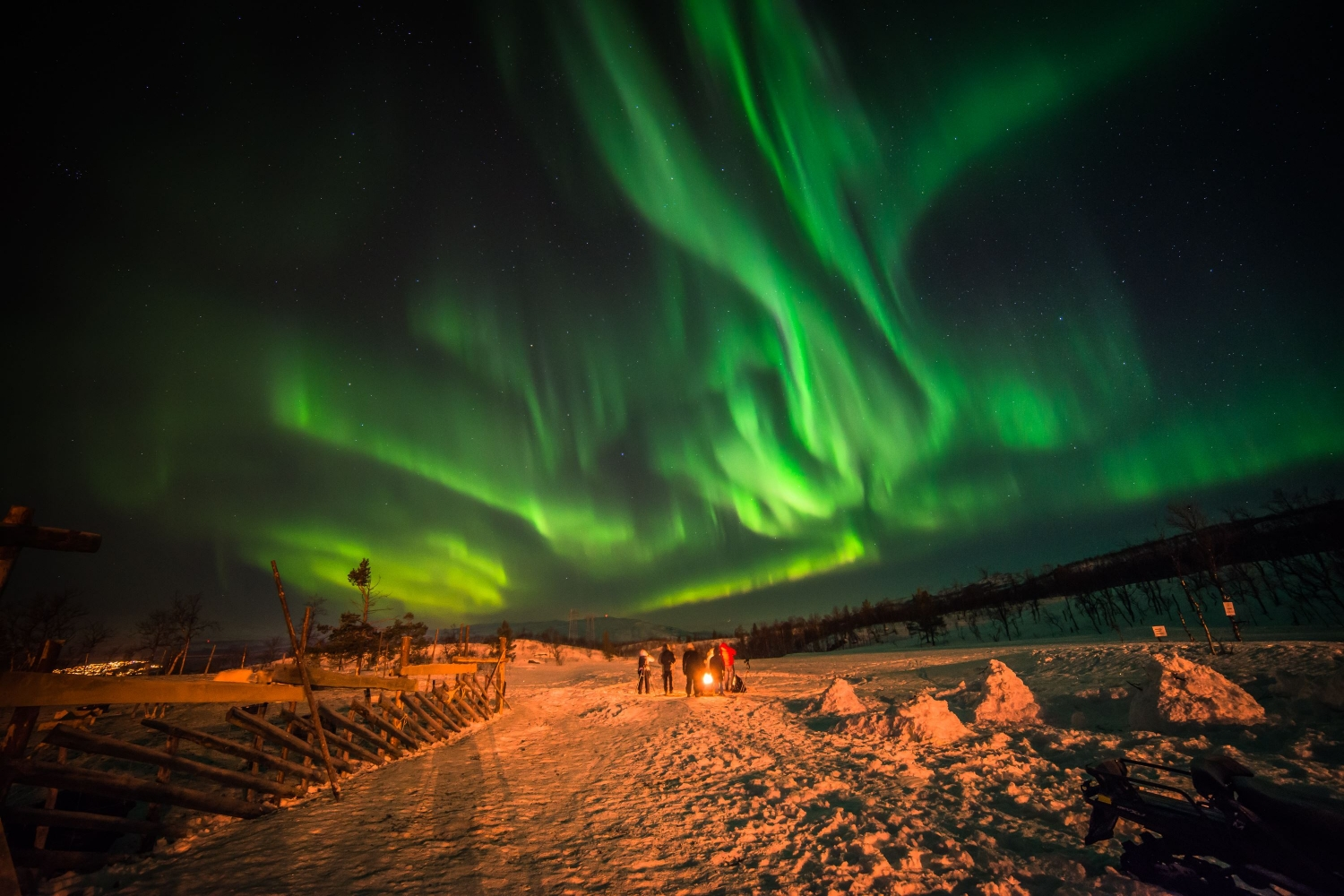 Northern Lights above snowy landscape