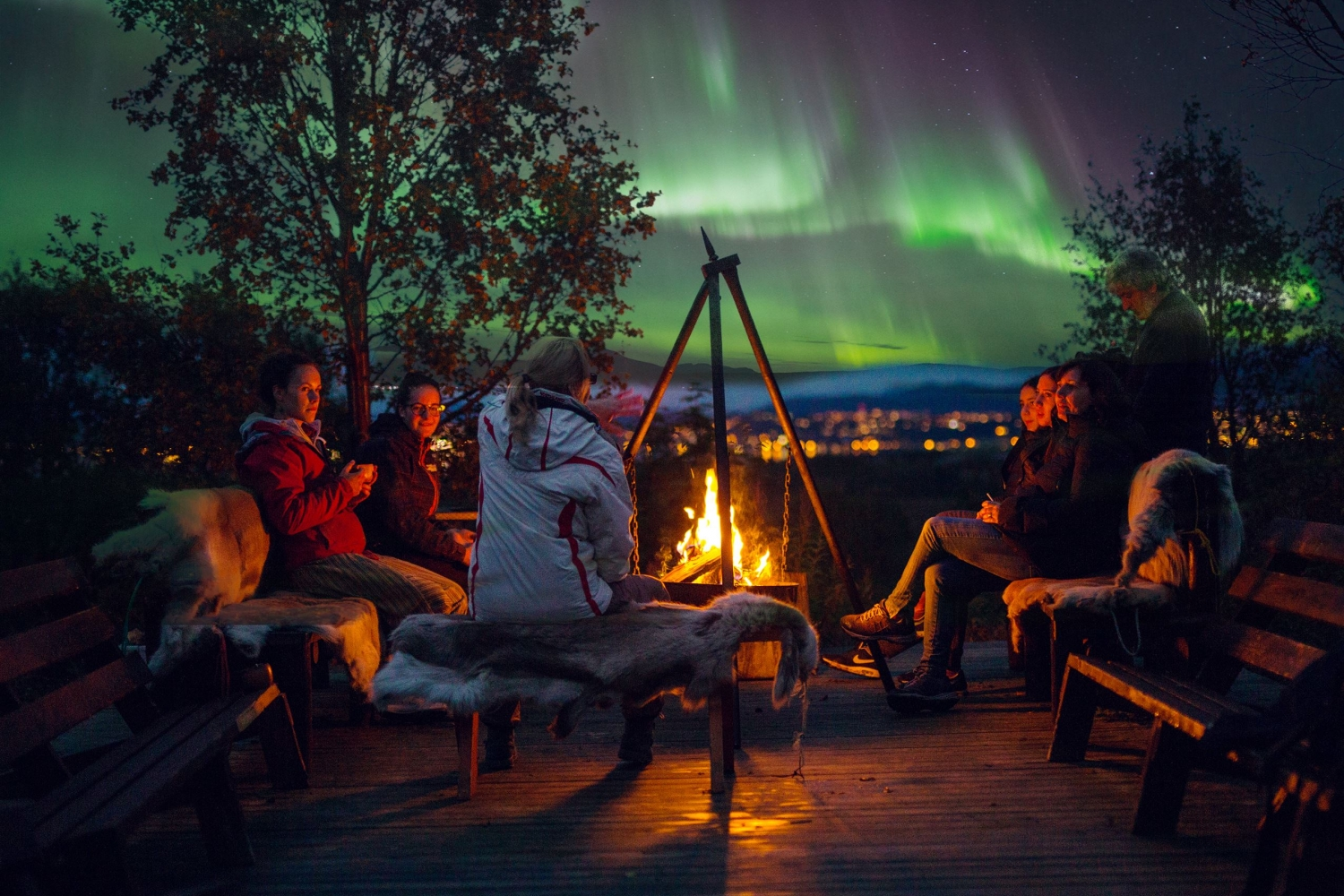 Guests gathered arount the bonfire, watching the Northern Lights