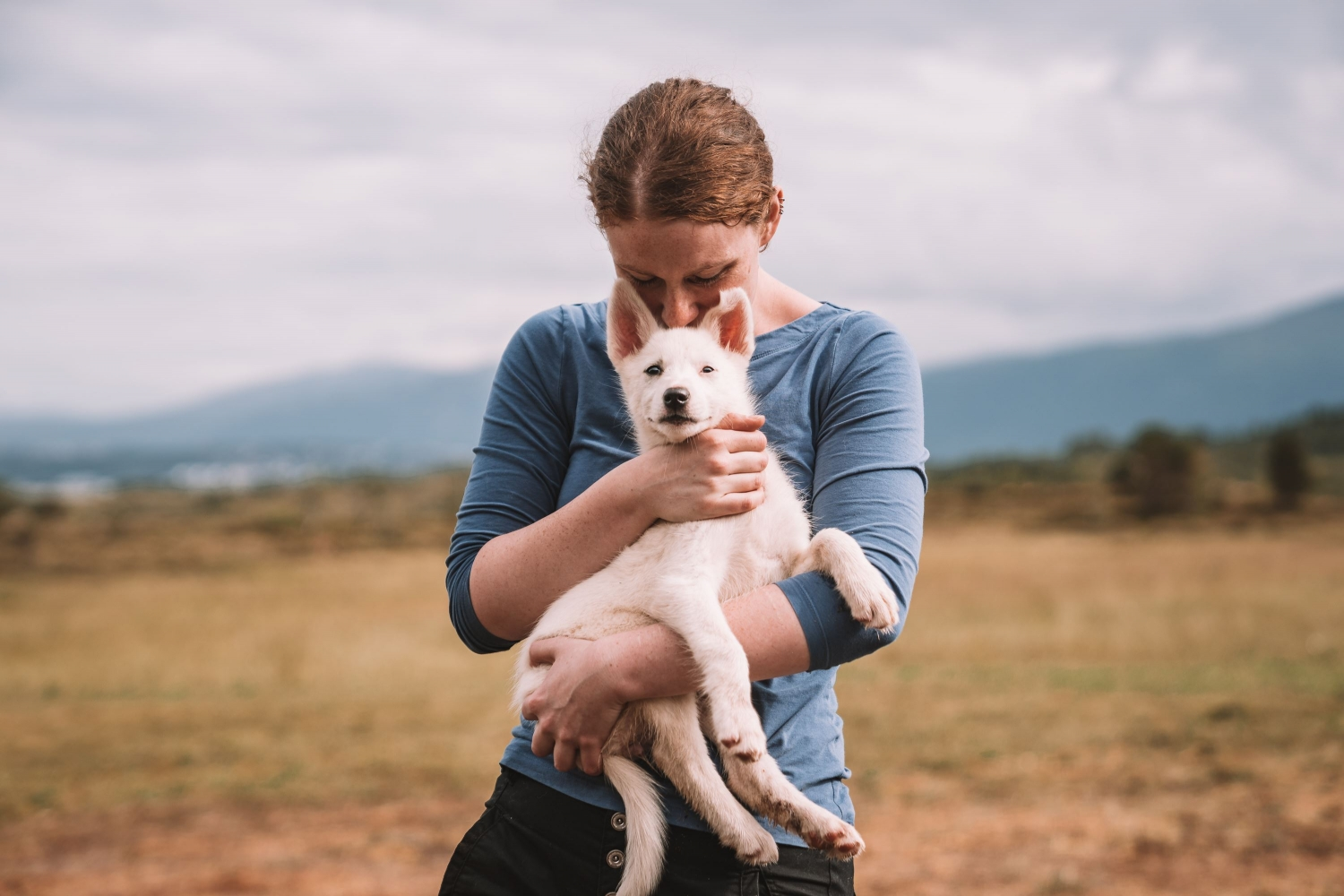 Lady holding a puppy