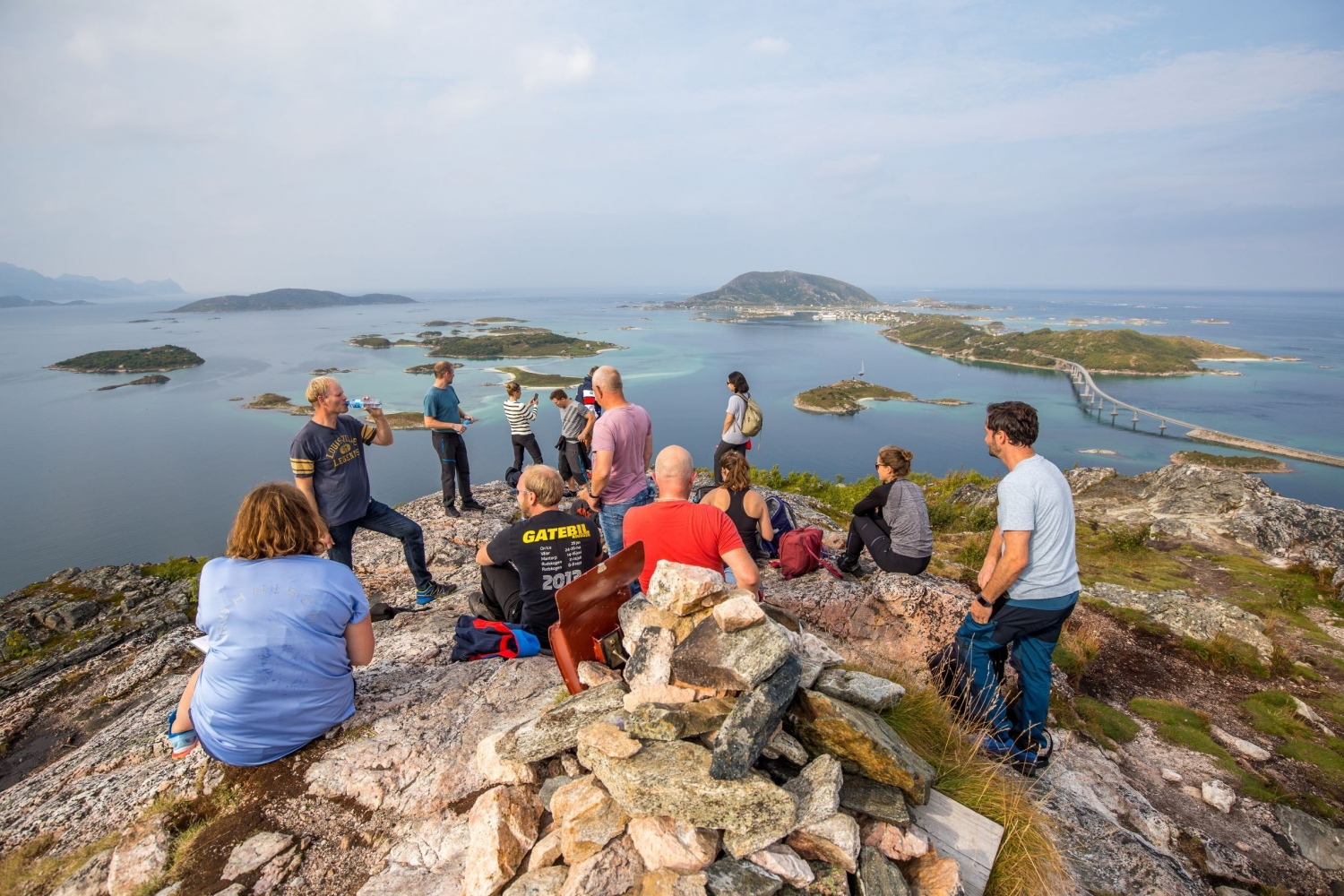 A group gathered on the top of a hill at Sommarøy