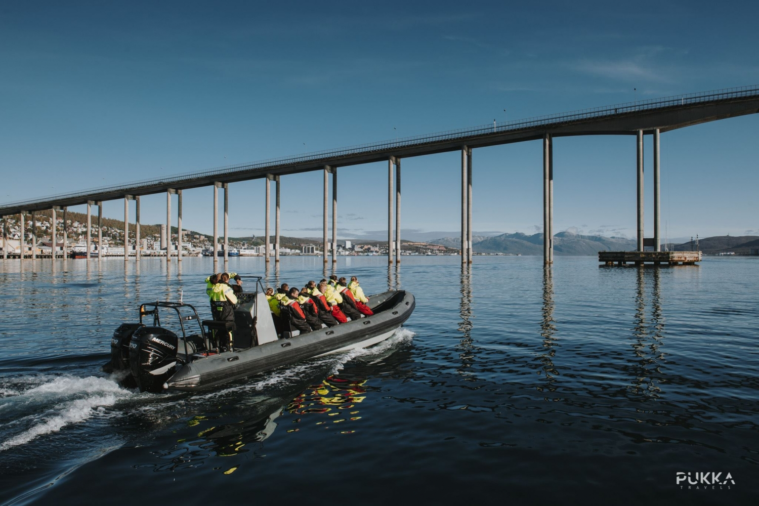 RIB about to drive under the Tromsø bridge