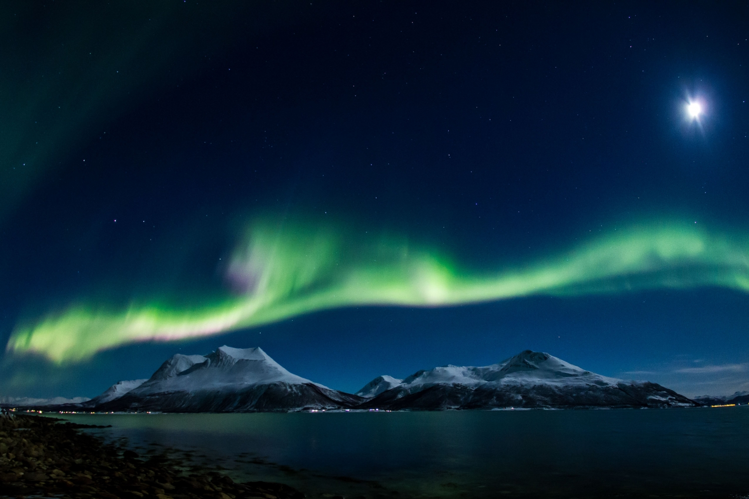 the northern lights over mountains