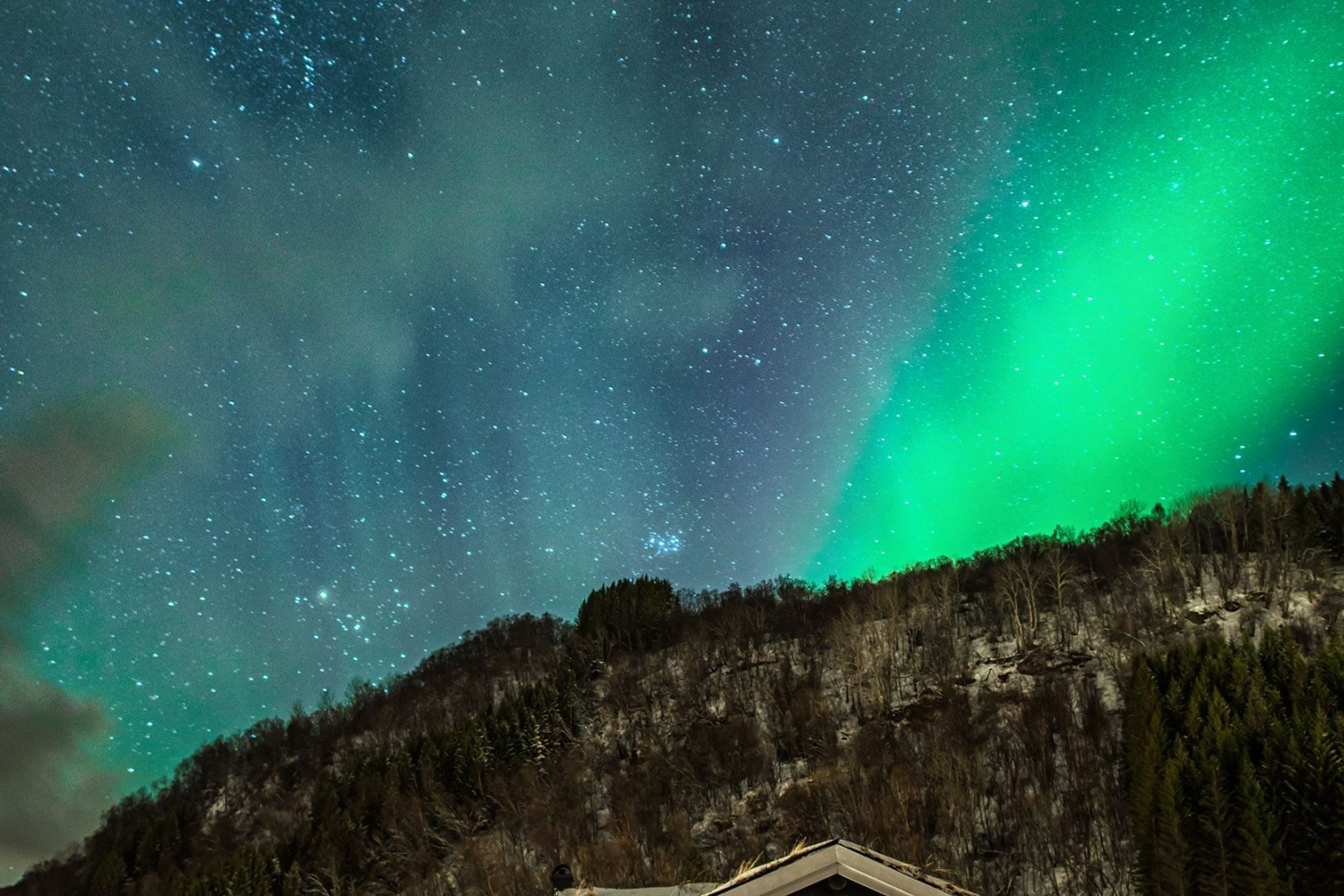 Northern Lights above a house