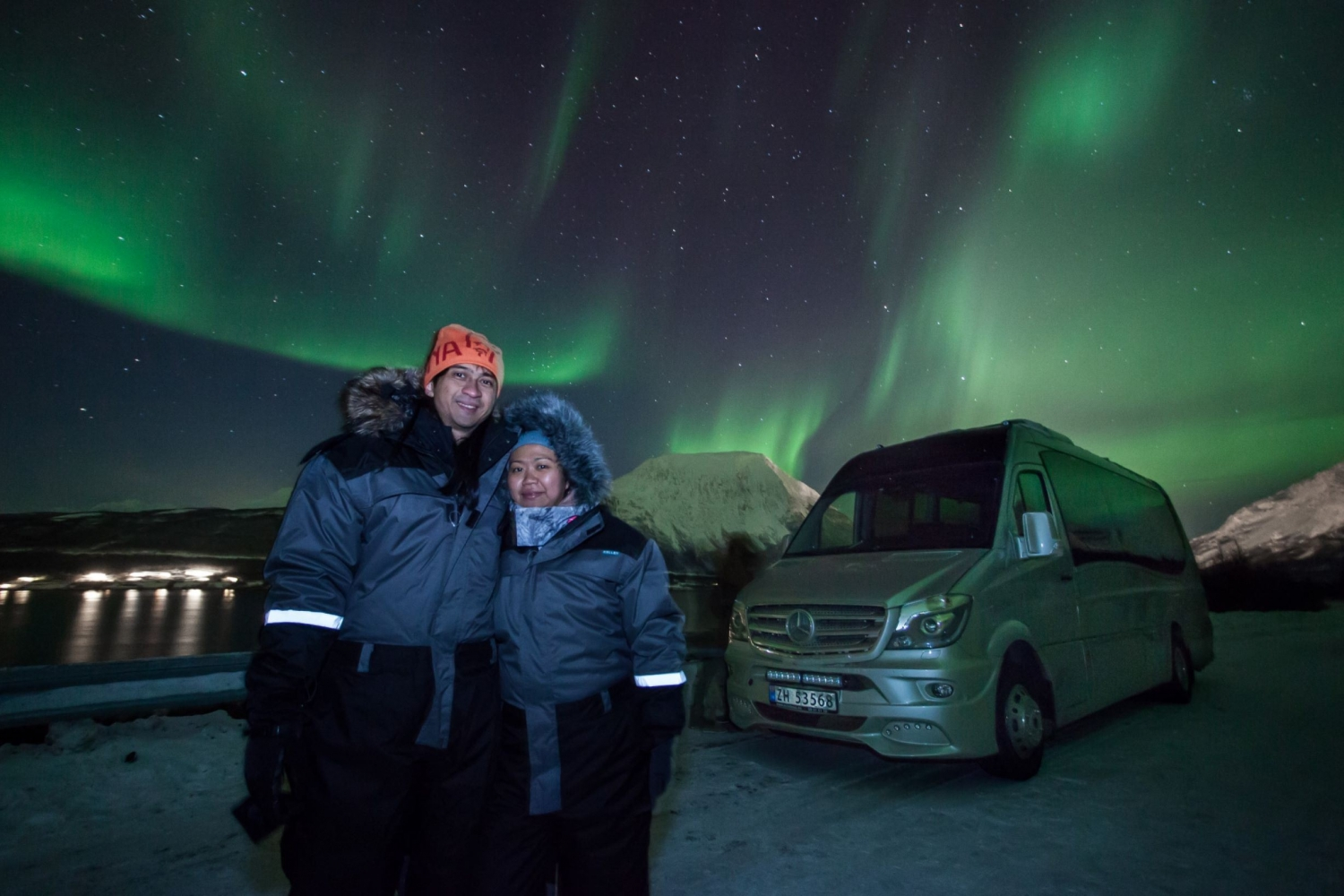two people infront of the northern lights