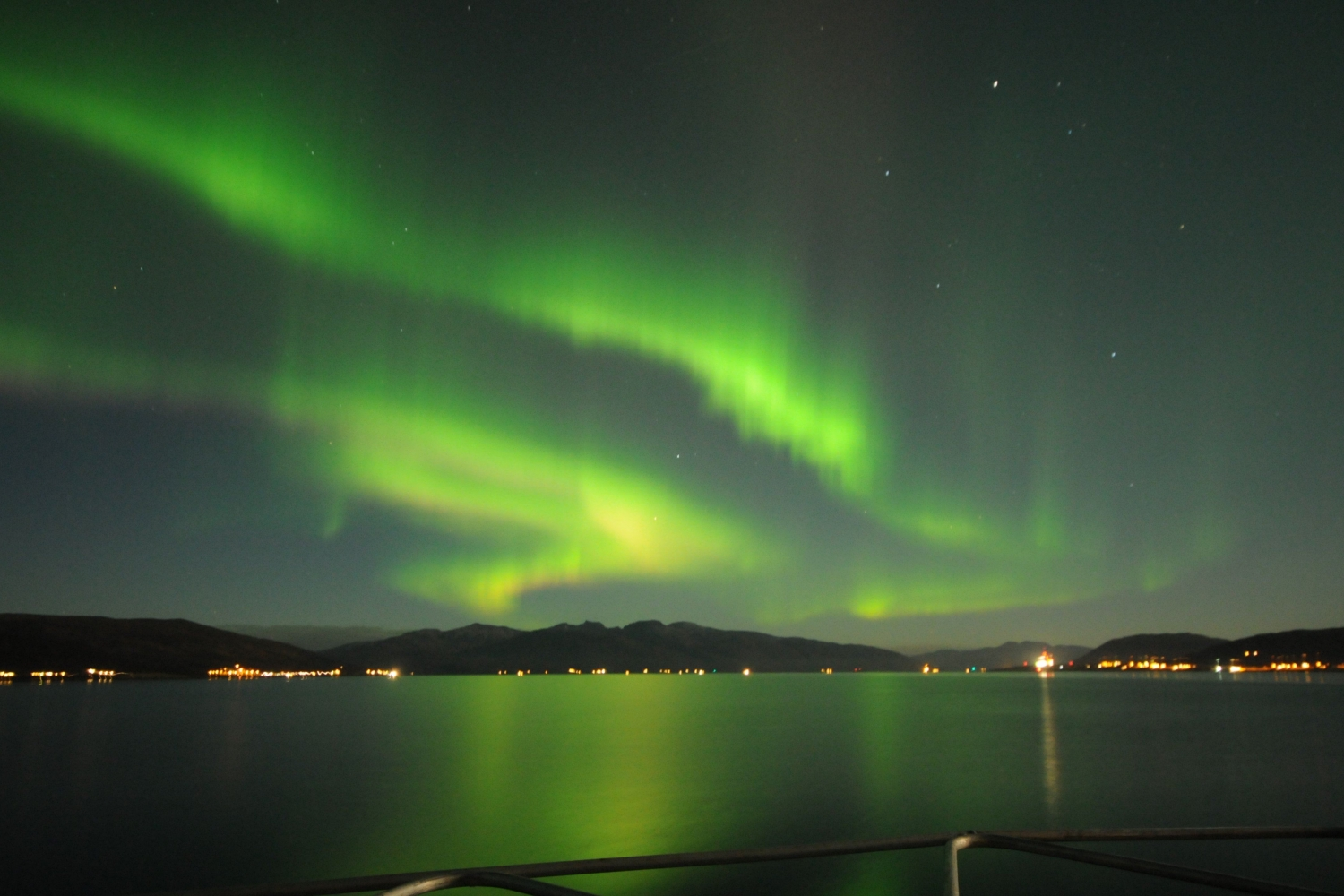 Northern Lights above the sea and mountains