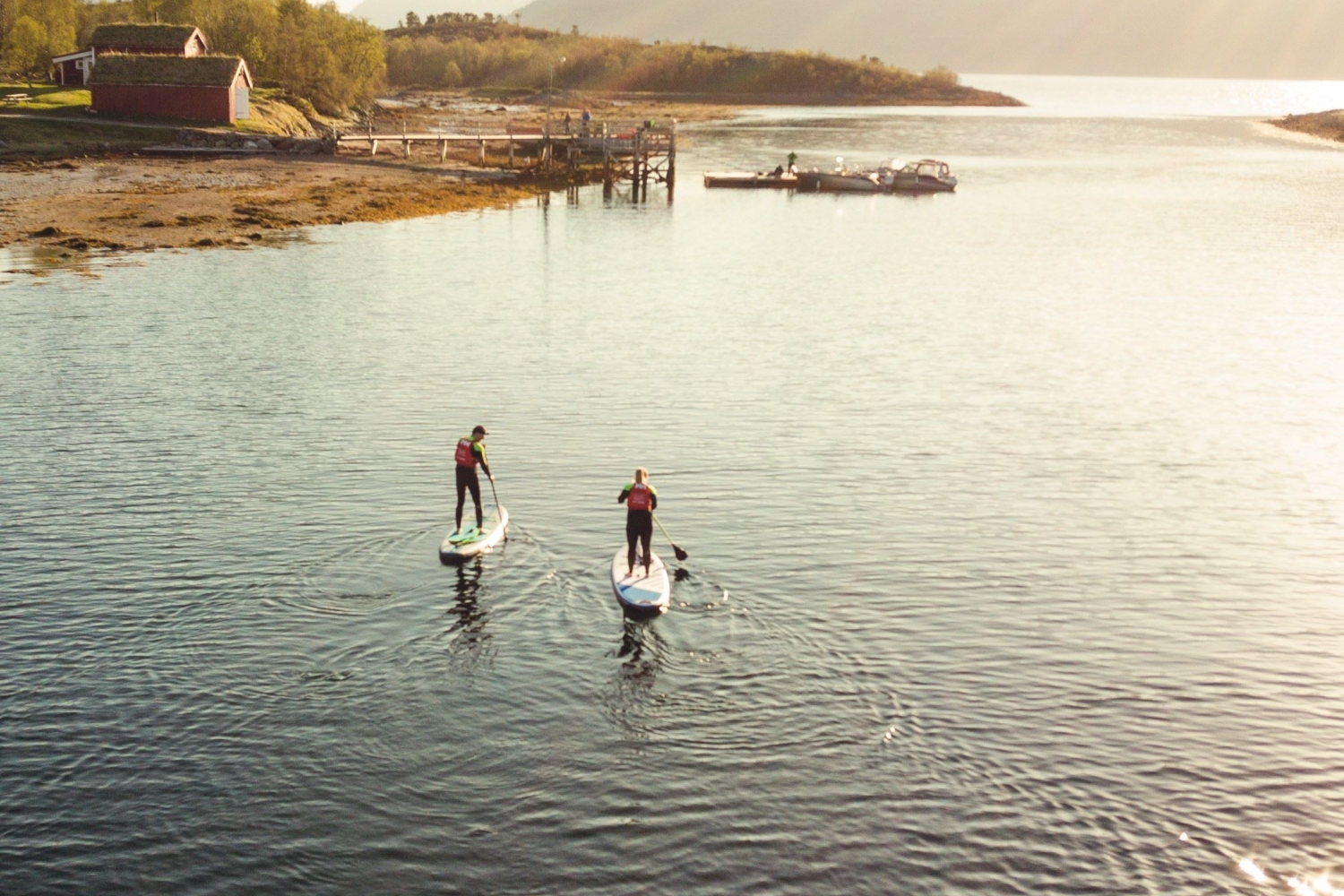 Two guests stand up paddling