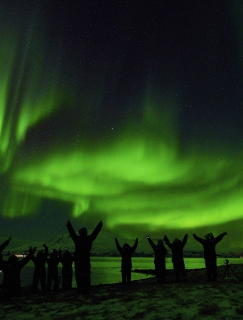 People paying tribute to the Northern lights on the sky