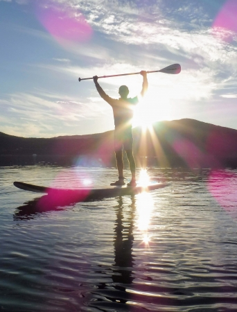 Person enjoying stand up paddling
