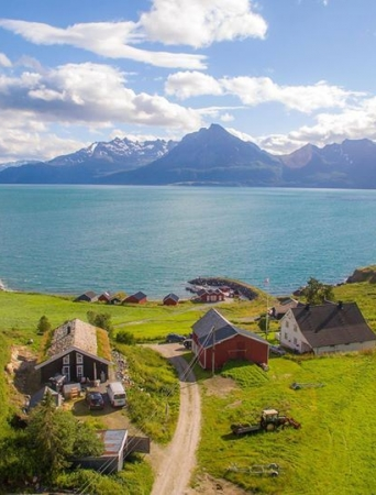 Drone photo view over Dyrøy Holiday, sea and mountains
