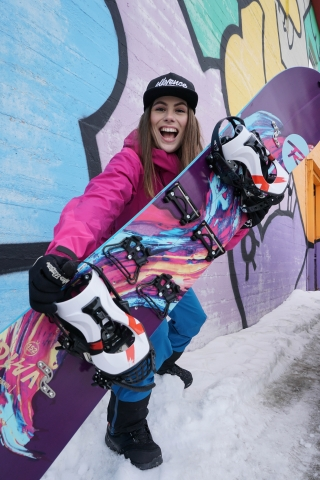 Mariann with her snowboard in the city centre