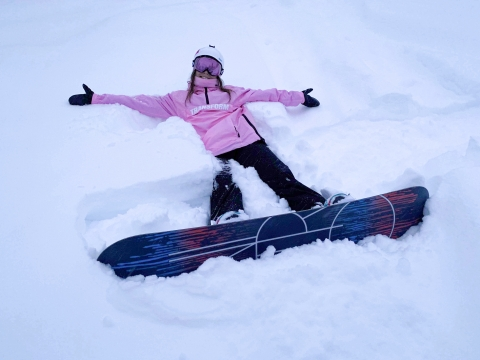 Mariann in the snow with her snowboard