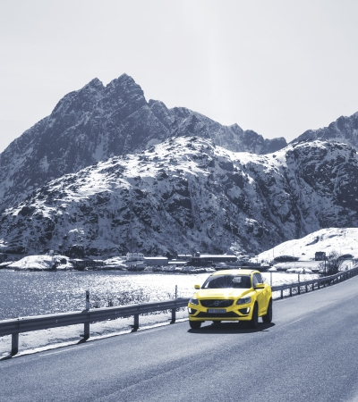 Yellow car driving on winter roads