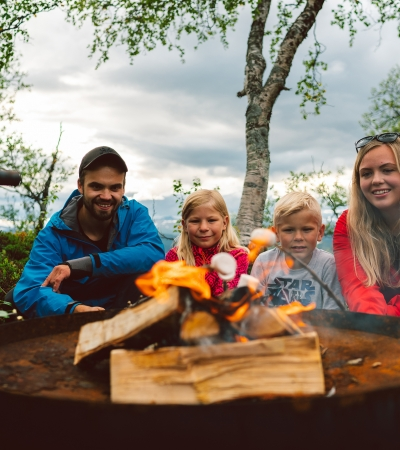 Family in front of bonfire