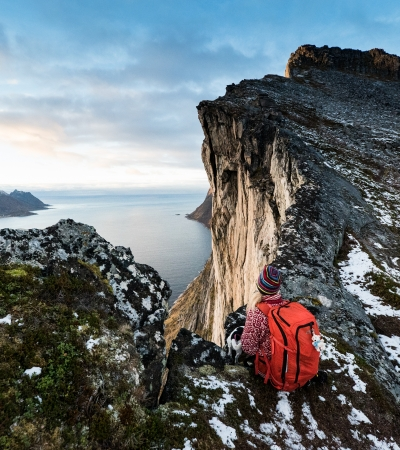 Woman enjoying the view from Segla mountain in Senja