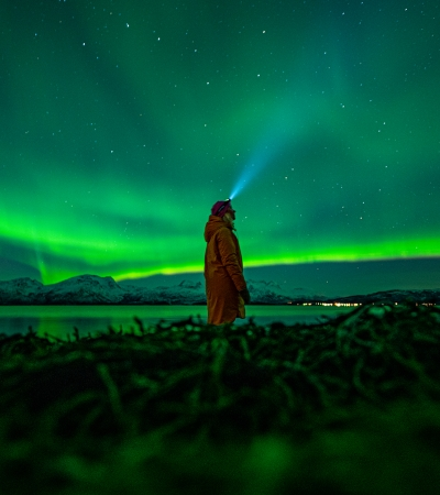 Woman watching the Northern Lights in Tromsø